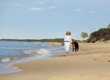Woman walks with dog Royalty Free Stock Photography