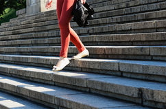 A woman walks down the stairs Stock Images