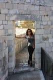 Woman Walks Dubrovnik's Walls Stock Photo