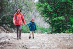 A woman walks with her son through the forest royalty free stock images