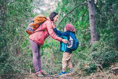 A woman walks with her son through the forest royalty free stock photography