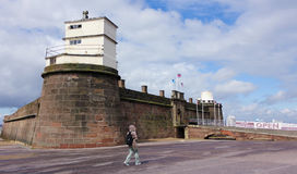 A Woman Walks Near to Fort Perch Rock, New Brighton Stock Photography