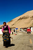A woman walks in a remote southern Tibetan Village Stock Photography