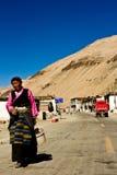 A woman walks in a remote southern Tibetan Village Stock Photography