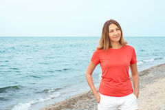 Woman walks by the sea Royalty Free Stock Images