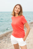 Woman walks by the sea Royalty Free Stock Photography