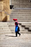 Woman walks in the Songzanlin Monastery. Shangri-La, China - September 25, 2017: Woman walks in the Songzanlin Monastery, built in 1679, is the largest Tibetan Stock Photos