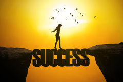 Woman walks on the success word Royalty Free Stock Images