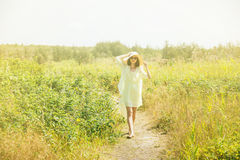 Woman walks in summer. Sunligh effect Stock Photography