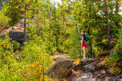 Woman walks up the mountain Royalty Free Stock Images