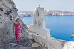 Woman walks up the mountain stairs. Greece Santorini Stock Photography