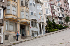 Woman Walks Up Steep Incline On Nob Hill Street Royalty Free Stock Photography