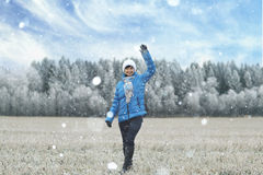 Woman walks in winter field Royalty Free Stock Photography