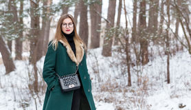 Woman walks in winter forest. Royalty Free Stock Image