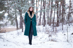 Woman walks in winter forest. Royalty Free Stock Photos