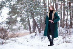 Woman walks in winter forest. Royalty Free Stock Photo