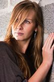 Woman and wall Royalty Free Stock Photography