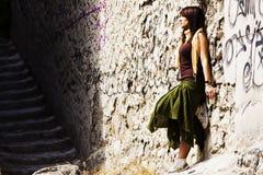 Woman on wall Stock Photo
