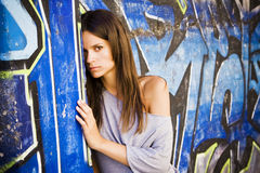 Woman in wall Stock Image