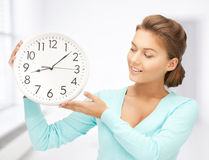 Woman with wall clock Royalty Free Stock Images