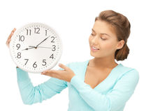 Woman with wall clock Stock Photo