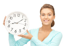 Woman with wall clock Stock Image