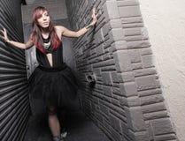 Woman between walls Stock Photography