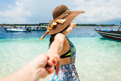 Woman wanting man to follow in honeymoon to beach Stock Photography