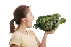 Woman wanting to eat savoy cabbage - isolated Stock Image