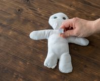 Woman wants a man in love with her and tries a voodoo doll,. A Woman wants a man in love with her and tries a voodoo doll Stock Photography