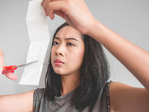 Woman wants to cut paper. Royalty Free Stock Images