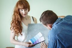 Woman wants to decorate. Young women wants to decorate new flat Stock Photo