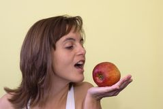 Woman wants to eat apple Royalty Free Stock Image