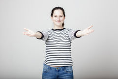 Woman wants to hug you. Attractive young woman wants to hug you and stretching his arms apart in hand Royalty Free Stock Image