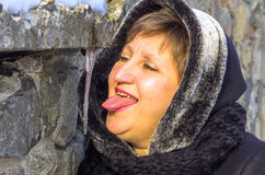 A woman wants to lick icicle Stock Image