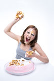 Woman wants to throw cake into the camera Royalty Free Stock Photo