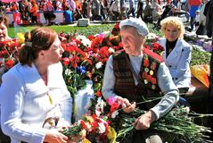 Woman war veteran talks to the other woman. Royalty Free Stock Images