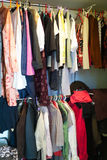 Woman wardrobe. With hanging clothes, vertical image stock image