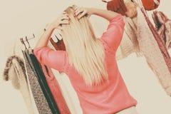 Woman in wardrobe choosing clothing Stock Photos