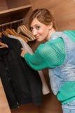 Woman and Wardrobe. Young beautiful woman looking at an empty wardrobe Stock Photo