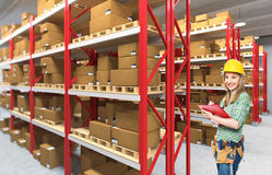 Woman in warehouse Stock Image