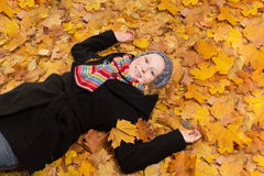 Woman warm clothes maple leaves Stock Photos