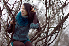 Woman in warm clothes positng outdoors. Stock Image
