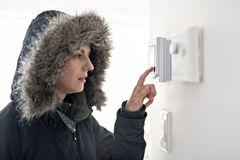 Woman With Warm Clothing Feeling The Cold Inside House. A Woman With Warm Clothing Feeling The Cold Inside House royalty free stock image
