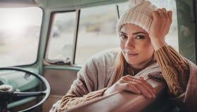 Beautiful woman on roadtrip travelling by van Stock Image
