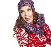 Woman in warm clothing on white background Royalty Free Stock Images