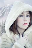 Woman in a warm coat Royalty Free Stock Photography