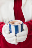 Woman in warm gloves holding cup of hot chocolate Stock Images
