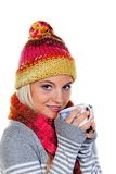 Woman with a warm hood with hot tea Royalty Free Stock Image