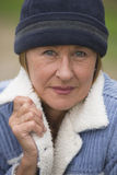 Woman in warm jacket and bonnet portrait Royalty Free Stock Photos